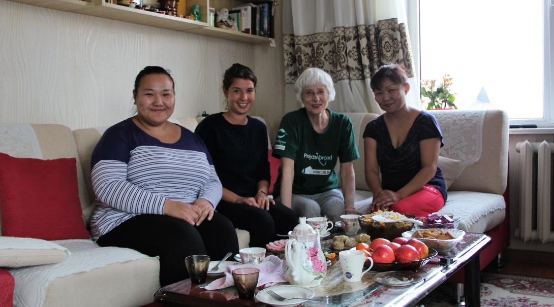 Retired volunteer with her host family in Mongolia